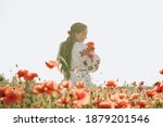Woman Holding Papaver Wreath On ...