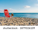 Straw Hat On Top Of A Red Chair ...