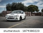 Small photo of Buenos Aires, year 2015: View of a white Mitsubishi Lancer Evolution IV. 90s japanese sportcar.