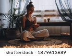 Young Woman Sitting On The...