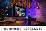 Small photo of Celebrating Virtual Christmas New Year's Eve party 2021 at home during Covid-19 pandemic. Couple holding and toasting champagne glasses How to celebrate and decorate foiled balloons of 2021.