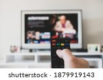 Small photo of tv control room netflix etc. platform and tv watching. smart watch tv controller changing channels. tv remote control changing channel netflix. remote control.Photo video available.In my video folder