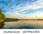 hot air balloons soaring over a ... | Shutterstock . vector #1879961503