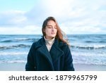 Young Beautiful Woman Braving A ...