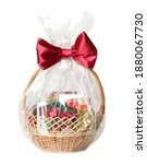 Small photo of Wicker basket full of gifts isolated on white