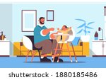 young father feeding his little ... | Shutterstock .eps vector #1880185486