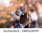 Closeup Of Microphone In Hand...