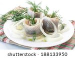 Stock photo salted herring with onion and dill on white background 188133950