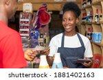 Female African Shop Attendant...
