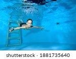 Beautiful Athletic Boy Swims...