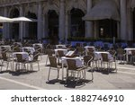 Small photo of idle vacuous cafe tables of empty San Marco fresh blue early morning