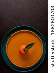 Tangerine On Plate On Black...