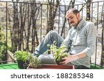 handsome stylish man gardening... | Shutterstock . vector #188285348