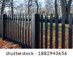 Long Black Spindle Fence On A...