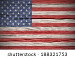 American Flag Over A Wooden...