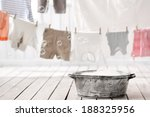 Stock photo old bowl with soft foam and pear on background hung wash laundry 188325956