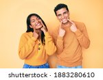 beautiful latin young couple... | Shutterstock . vector #1883280610