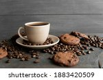 Coffee Cup With Cookies On...