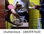 """Small photo of A medical staff receives the delivery of the vaccines at """"La Bonne Maison de Bouzanton"""" care home during a vaccination operation in Mons, Belgium on Dec. 28, 2020."""