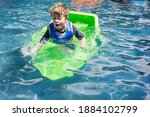 Young Boy In Swimming Pool With ...