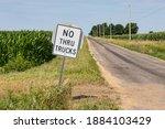 No Thru Trucks Road Sign Along...