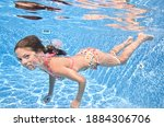 Child Swims Underwater In...