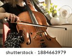 Small photo of A female musician playing the cello.