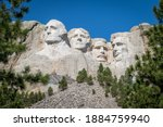 Small photo of The busts of Presidents George Washington, Thomas Jefferson, Teddy Theodore Roosevelt, and Abraham Lincoln carved Borglum into the Black Hills of South Dakota at Mount Rushmore