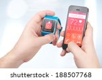 Small photo of Data synchronization of health book between smartwatch and smartphone in male hands