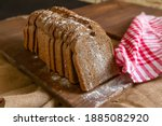 Rye Bread On Rustic Wood And...