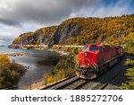 A Freight Train Hauls Shipping...