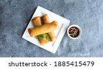 Small photo of deep fried spring rolls, Por Pieer Tod or Fried spring rolls (Thai Spring Roll) Snacks and snacks that are popular with Thai and Chinese people.