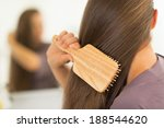 Closeup On Young Woman Combing...