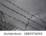 A Silhouette Of Barbed Wire...