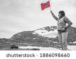 Woman Holds Norwegian Flag In...
