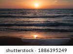 Sunset Over The Shore Of...