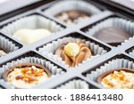 different chocolate pralines.... | Shutterstock . vector #1886413480