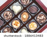 different chocolate pralines.... | Shutterstock . vector #1886413483