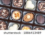 different chocolate pralines.... | Shutterstock . vector #1886413489