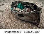 An Old Boat On A Shingle Beach