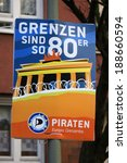 "Small photo of CIRCA APRIL 2014 - BERLIN: an election poster to the upcoming european elections from the ""Piratenpartei"" (pirate party) with the slogan ""Grenzen sind so 80er"" (borders are so 80s), Berlin."