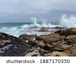 Waves Crashing On Rocks....
