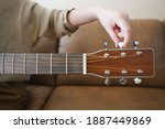 Woman Hands Tuning Acoustic...