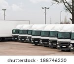 Small photo of Company fleet of commercial lorries parked in a row ready for cargo distribution