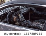 Burnt Car Close Up. Steering...