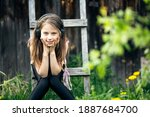 Small photo of Girlie enjoy music with headphones in the country outdoors.