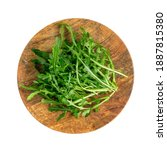 Small photo of Arugula on wooden plate isolated. Fresh arugula, ruccola leaves, rucola, eruca or garden roquette salad top view