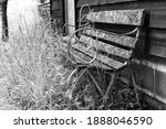Old Bench Decaying Against An...
