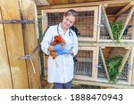 Happy young veterinarian woman...