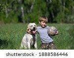 Boy Hugs Large Dog With One...